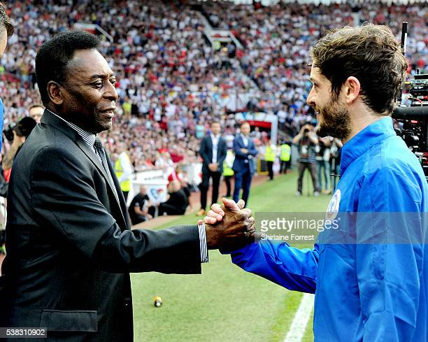 Pele greets actor Iwan Rheon during Soccer Aid at Old Trafford on June 5 2016 in Manchester England