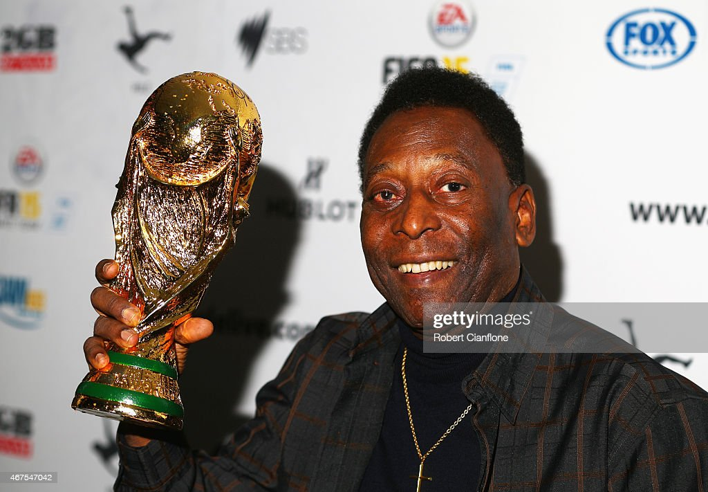 Pele holds a replica Wolrd Cup trophy during a press conference at The Peninsula on March 26, 2015 in Melbourne, Australia.