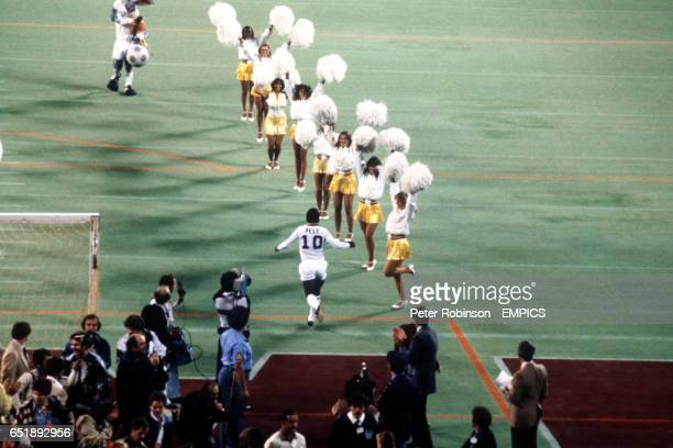 Pele making a surprise appearance in New York Cosmos kit is cheered onto the pitch by the Cosmos cheerleaders as Cosmos mascot Bugs Bunny waits to...