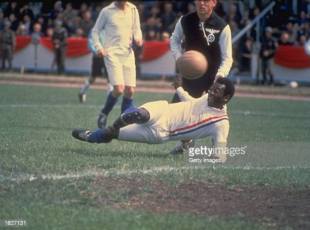 Pele of Brazil scores the equalizing goal for the Allied POW's during the match against Germany in Paris featured in the filming of ''Escape to...