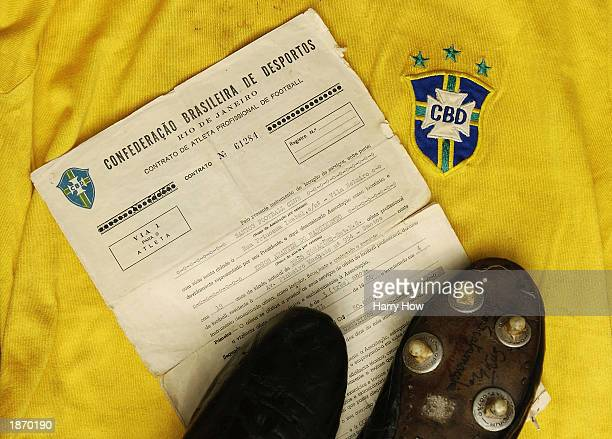 Pele of Brazil's original 1960 contract boots worn scoring his 1000th career goal and jersey on display for the future Christie's Sports Memorabilia...