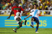 Pele of Portugal is challenged by Jose Castillo of Guatemala during the FIFA U20 World Cup 2011 round of 16 match between Portugal and Guatemala at...