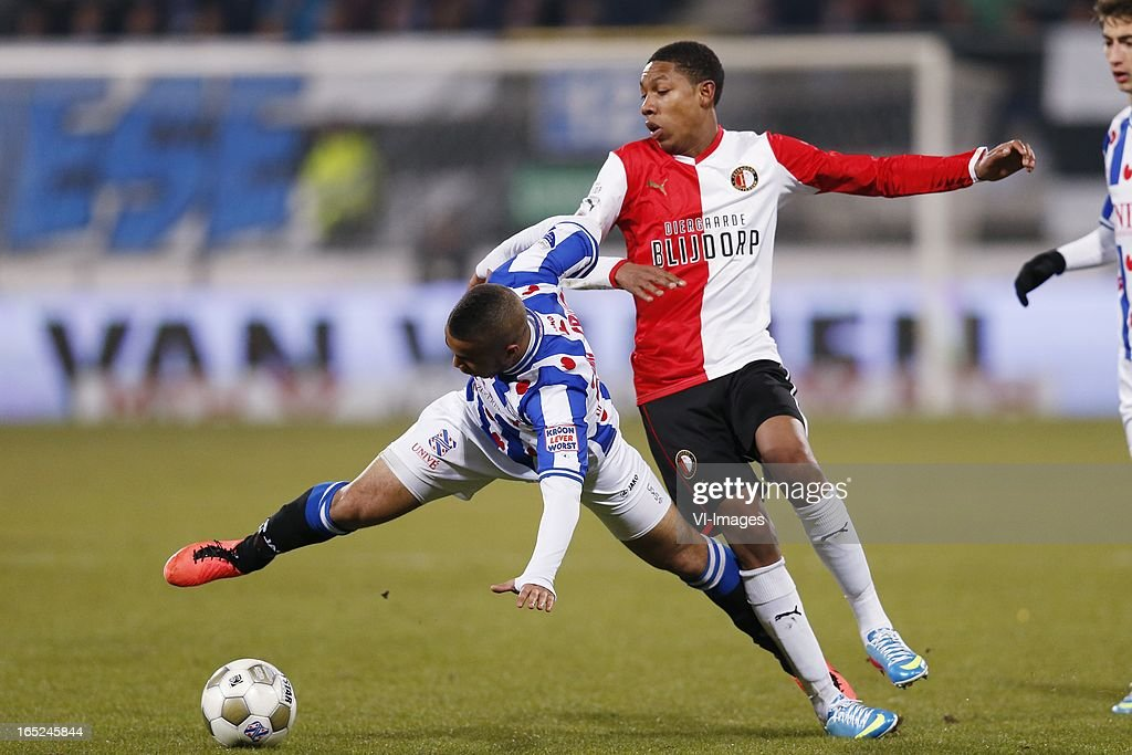 Pele van Anholt of Heerenveen,Jean-Paul Boetius of Feyenoord during the Dutch Eredivisie match between SC Heerenveen and Feyenoord at the Abe Lenstra Stadium on march 30, 2013 in Heerenveen, The Netherlands