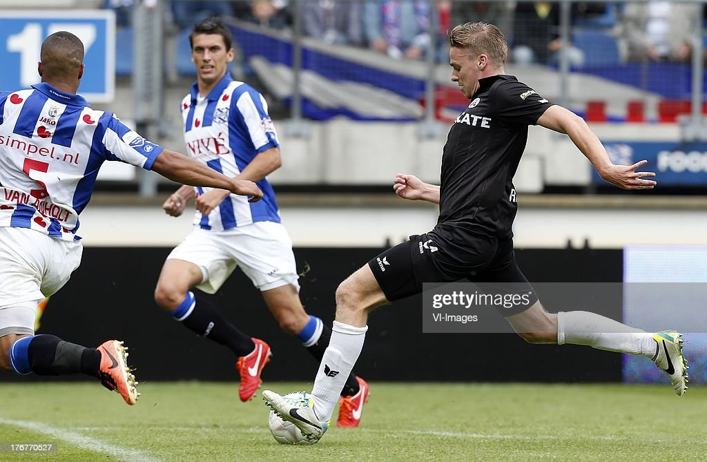 Pele van Anholt of SC Heerenveen (L), Ben Rienstra of Heracles Almelo (R) during the Dutch Eredivisie match between sc Heerenveen and Heracles Almelo on August 18, 2013 at the Abe Lenstra stadium in Heerenveen, The Netherlands.