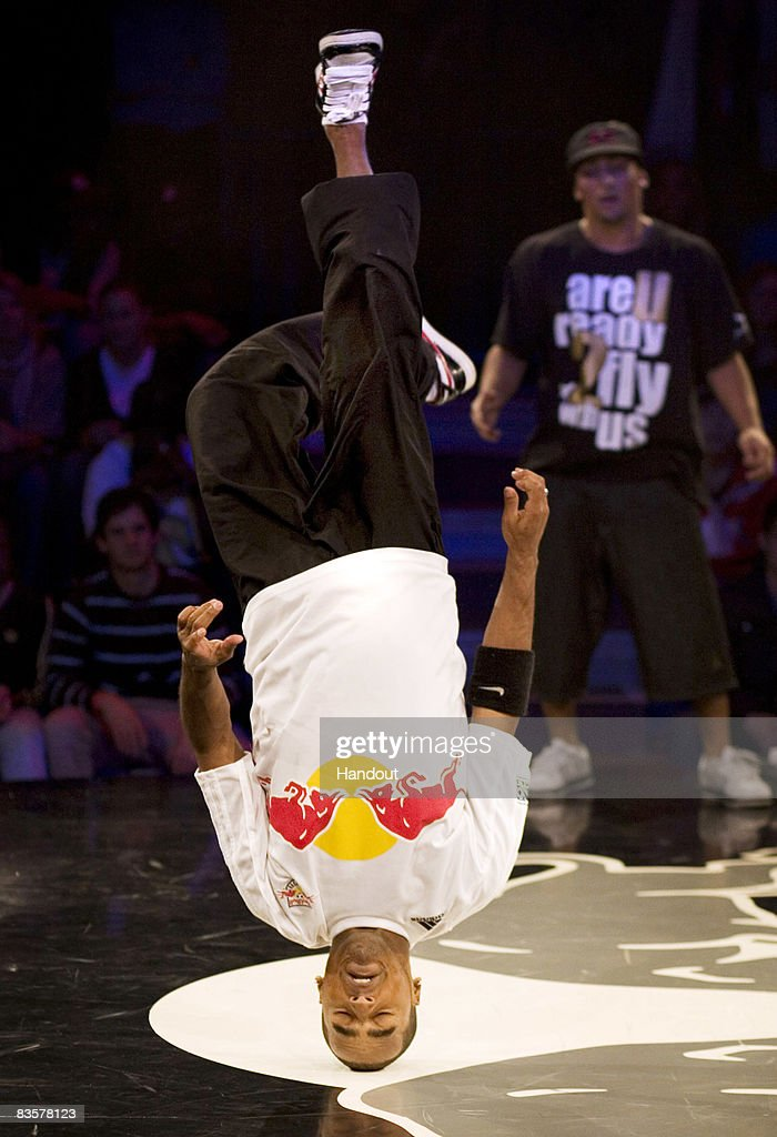 Pelezinho (L) of Brazil performs as Lil Ceng (R) of Germany watches on during the Red Bull BC One breakdance competition on November 5, 2008 in Paris, France. Sixteen of the world's best B-Boys compete in one-on-one knockout battles to determine the winner.