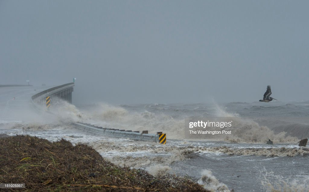 A pelican fights the wind as water rises over Interstate 10 at Lake Pontchartrain during Hurricane Isaac on August 29 2012 in New Orleans La