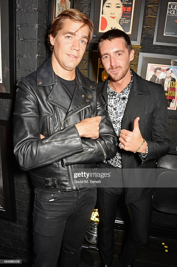Pelle Almqvist (L) and <a gi-track='captionPersonalityLinkClicked' href=/galleries/search?phrase=Miles+Kane&family=editorial&specificpeople=4860678 ng-click='$event.stopPropagation()'>Miles Kane</a> attend as John Varvatos launch their first European store in London, on September 3, 2014 in London, England.