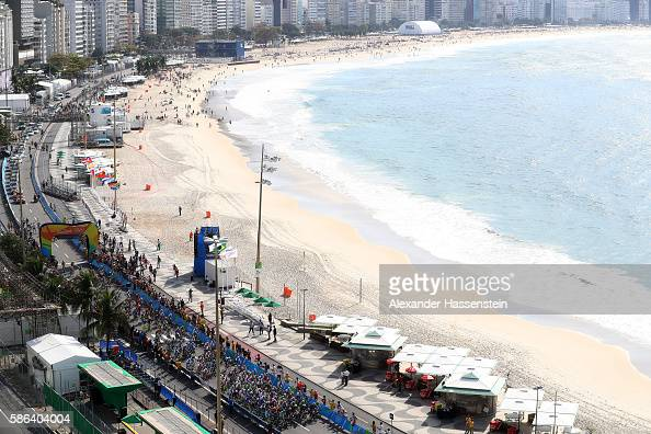 Peloton ride through Copacabana beach during the Men's Road Race on Day 1 of the Rio 2016 Olympic Games at the Fort Copacabana on August 6 2016 in...