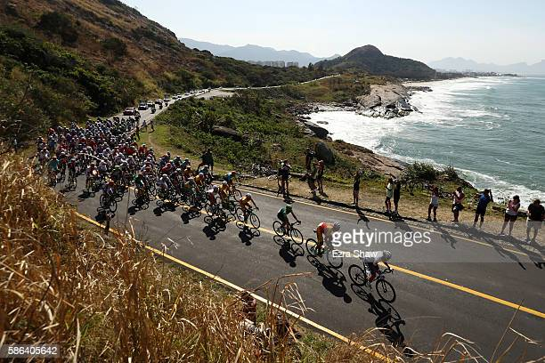 Peloton roll through Grumari during the Men's Road Race on Day 1 of the Rio 2016 Olympic Games at the Fort Copacabana on August 6 2016 in Rio de...