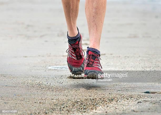 UK, Pembrokeshire, Whitesands bay, Mature woman running on sand