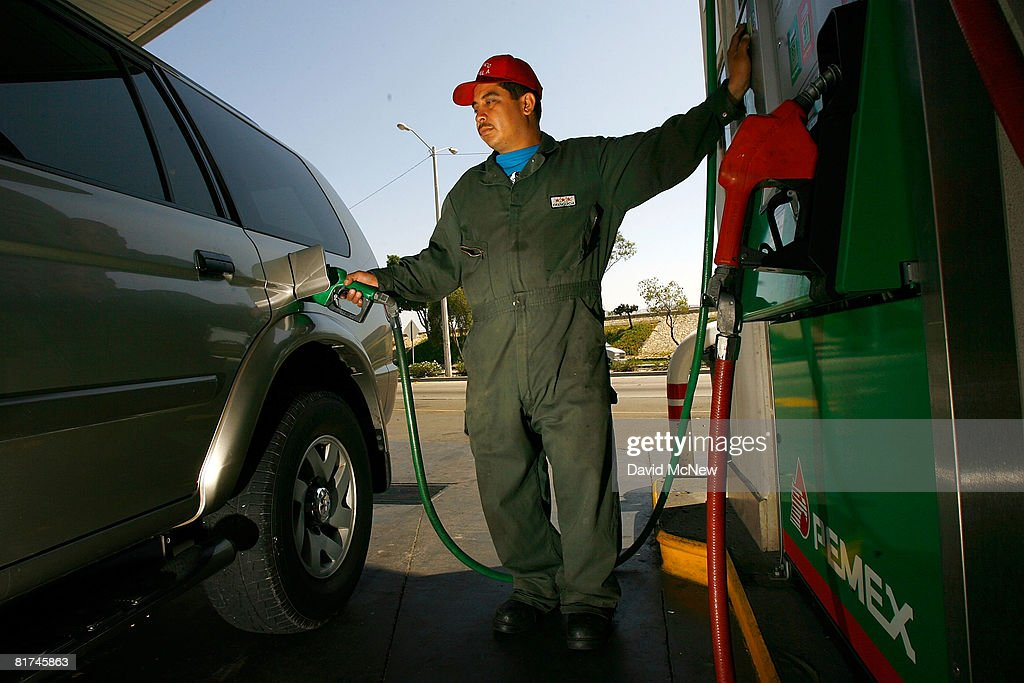 Pemex gas station attendant fills a car registered with a California license plate on June 27 2008 in Tijuana Mexico With the cost of gasoline in...