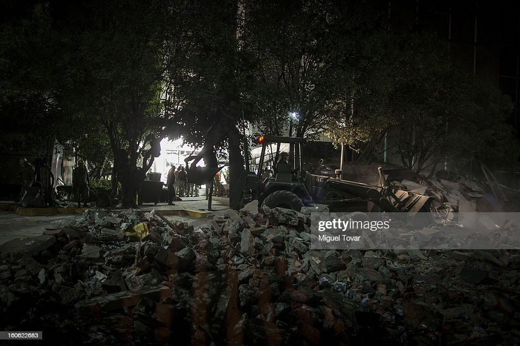Pemex workers continue Efforts on document retrieval and searching of human bodies in Affected Levels of the administrative building of PEMEX on February 03, 2013 in Mexico City, Mexico. Authorities Investigate That blast killed at least 34 people at at the state-owned companyÕs headquarters in Mexico City.