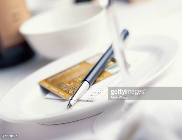 Pen and credit card on plate