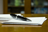 A macro view of pen and paper with highlighted depth of field