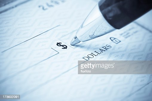 Pen being used to write a check