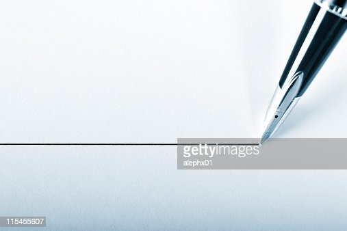 A pen drawing a precision point line on white paper