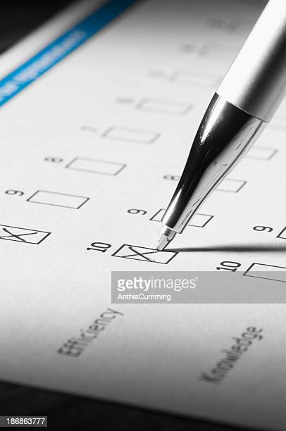 Pen filling in customer satisfaction survey with crosses