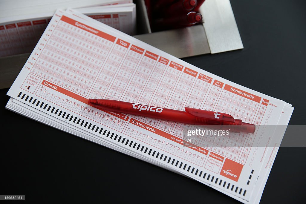 A pen lies on a betting slip in the flagship store of sports waging company 'tipico' is pictured in Hamburg, northern Germany, on January 15, 2013. AFP PHOTO / OLIVER HARDT