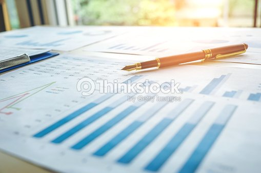 pen on the business paper report chart stock photo thinkstock