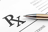 Pen on the prescription form. Close up.  Medical concept.
