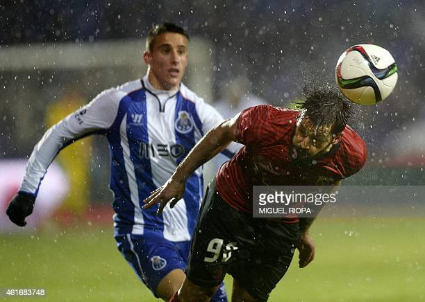 Penafiel's midfielder Vitor Bruno vies with Porto's Spanish forward Cristian Tello during the Portuguese liga football match FC Penafiel vs FC Porto...