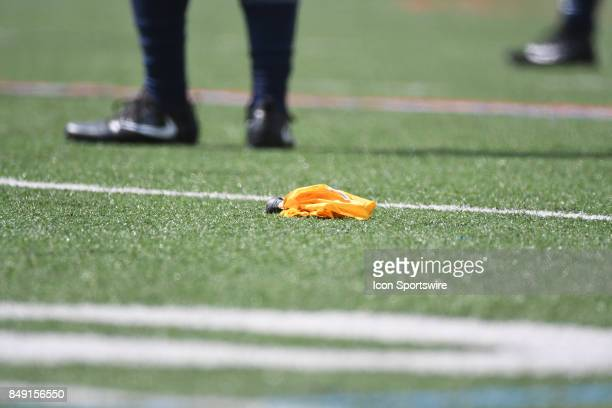 Penalty flag sits on the field during a college football game between the Penn Quakers and the Ohio Dominican Panthers on September 16 2017 at...