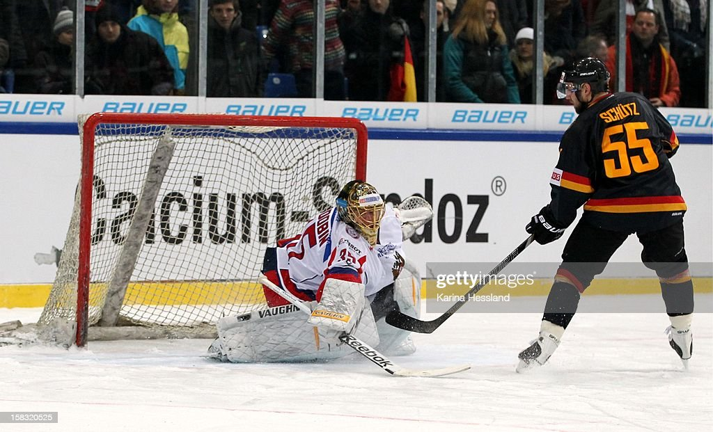 Penalty Kick, Felix Schuetz of Germany challenges Goalkeeper Anton Khudobin of Russia during the Top Teams Sotchi match between Germany and Russia at Kuechwaldhalle on December 11, 2012 in Chemnitz, Germany.