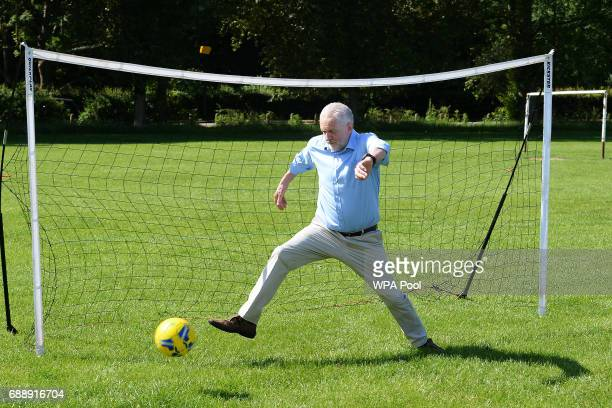 A penalty kick from a child gets past Labour Party leader during a visit to Hackney Marshes Football Pitches to highlight Labour's manifesto...