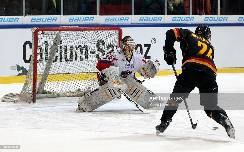 Penalty Kick, Martin Hinterstocker of Germany challenges Goalkeeper Anton Khudobin of Russia during the Top Teams Sotchi match between Germany and Russia at Kuechwaldhalle on December 11, 2012 in Chemnitz, Germany.