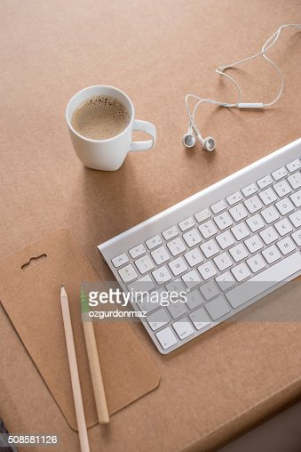 Pencil, coffee, keyboard and headphone on desk : Stock Photo