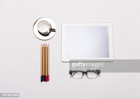 pencil, cup, digital tablet, glasses