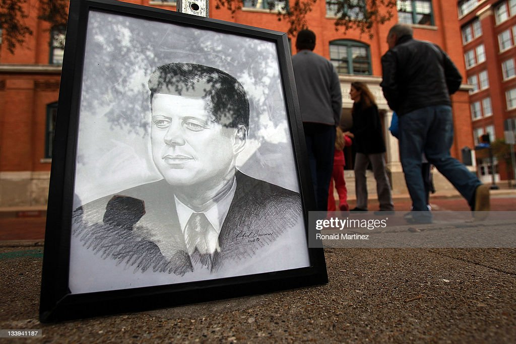 A pencil drawing of John F. Kennedy sits in Dealey Plaza during the 48th anniversary of his assassination on November 22, 2011 in Dallas, Texas. The 48th anniversary of the assassination of U.S. President John F. Kennedy while riding in a Presidential motorcade in Dealey Plaza will be marked on November 22