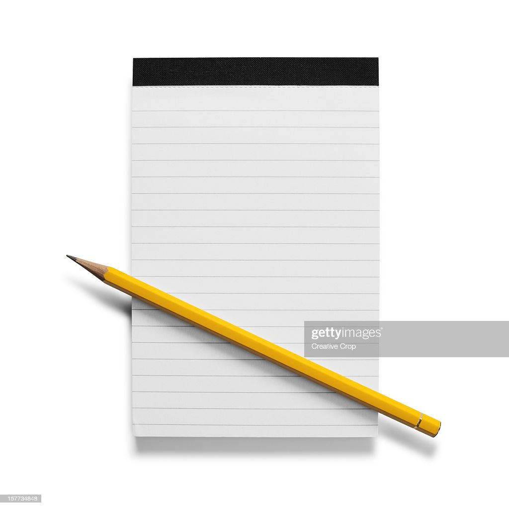 Pencil pen sat on blank lined writing pad