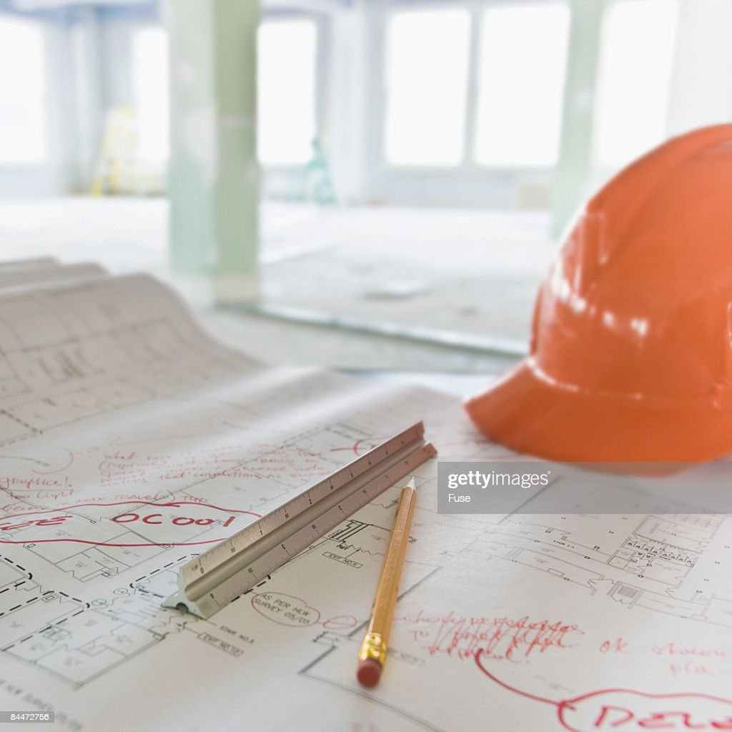 Pencil, Ruler and Building Plans in Empty Building