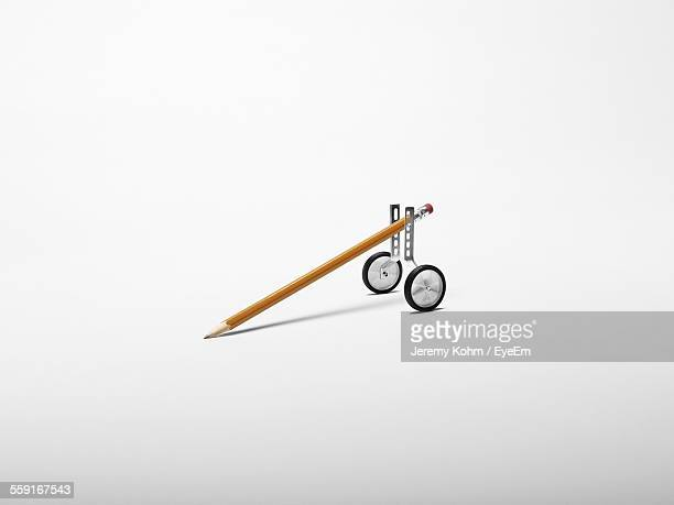 Pencil With Training Wheels Against White Background
