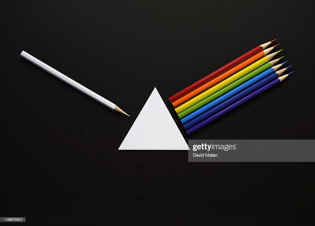 Pencils and paper forming a prisim and spectrum : Stock Photo