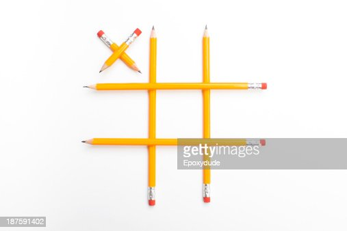 Pencils arranged into a tic-tac-toe game with a single X played