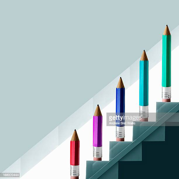 Pencils climbing a staircase symbolising growth