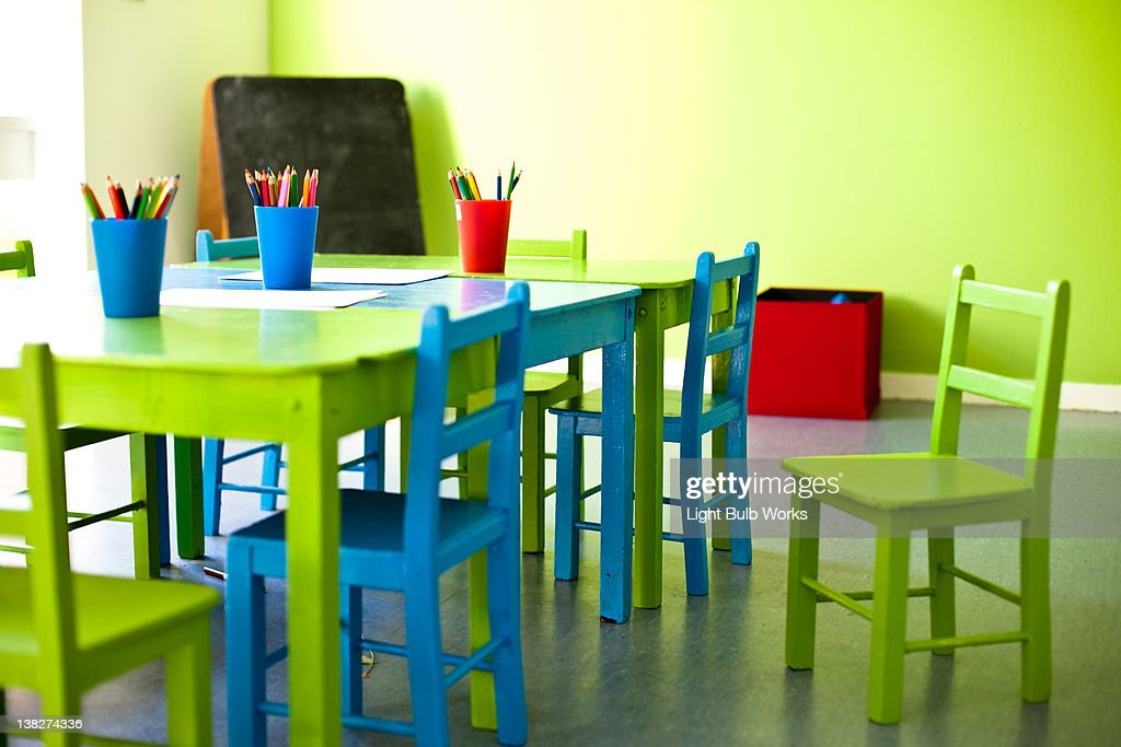 Pencils in glass on table : Stock Photo