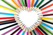 Heart-shaped gap, image heart form pencils on white background.
