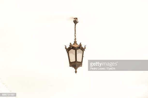 Pendant Light Hanging From White Background