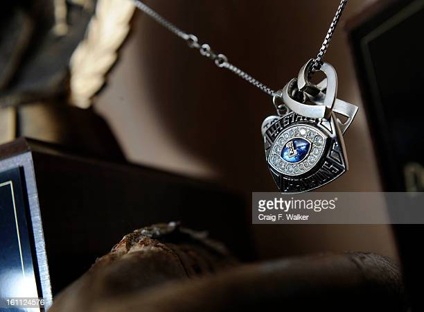 A pendent is part of the football memorabilia that decorates Katherine Korosec's home in Wheat Ridge CO Katherine is the mother of UNC quarterback...