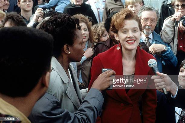 Penelope Ann Miller is approached by reporters in a scene from the film 'The Gun In Betty Lou's Handbag' 1992