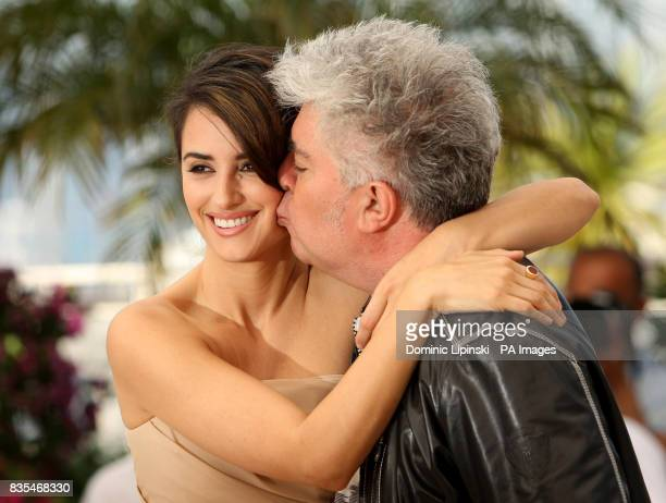 Penelope Cruz and Pedro Almodovar attend a photocall for the film Broken Embraces held at the Palais des Festivals in Cannes France as part of the...