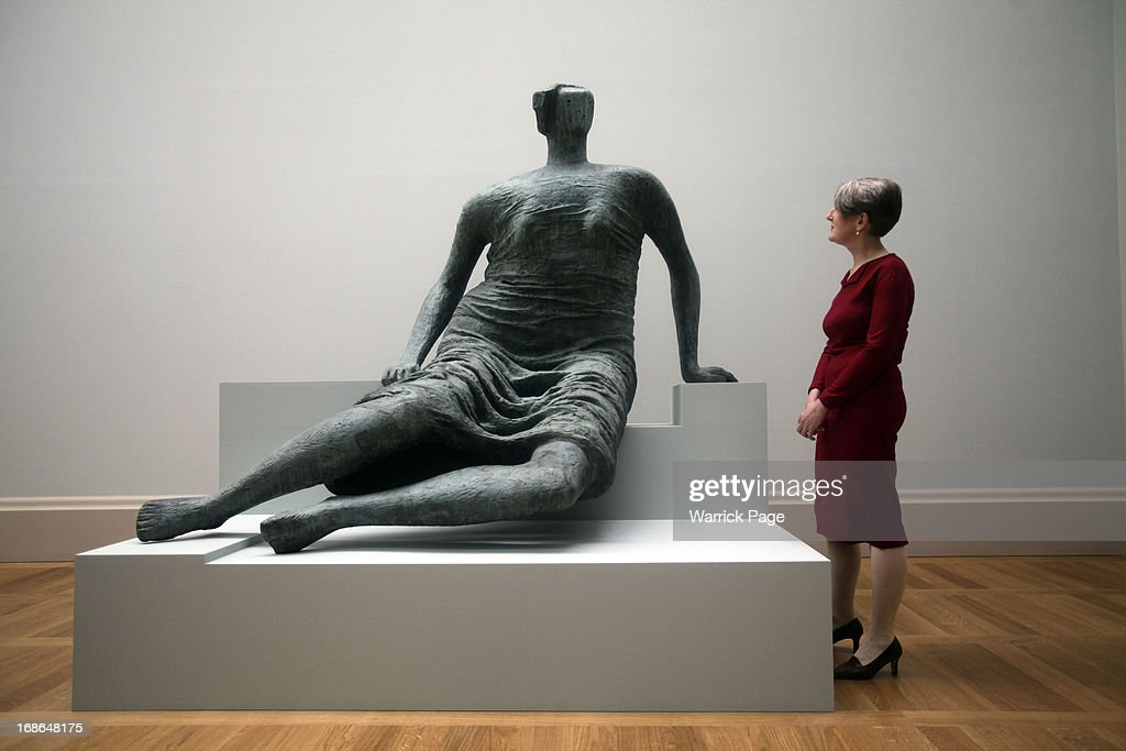 Penelope Curtis, Director of Tate Britain, stands next to the Henry Moore sculpture Draped Seated Figure which is on display at the Walk through British Art exhibition at Tate Britain on May 13, 2013 in London, England. Visitors will experience a completely new presentation of the world's greatest collection of British art, the national collection of British art will be displayed in a continuous and purely chronological display from the 1500s to the present day.