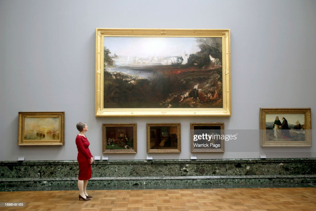 Penelope Curtis, Director ofTate Britain, standing next to the painting by John Martin The Last Judgement 1853 on display at the Walk through British Art exhibition at Tate Britain on May 13, 2013 in London, England. Visitors will experience a completely new presentation of the world's greatest collection of British art, the national collection of British art will be displayed in a continuous and purely chronological display from the 1500s to the present day.