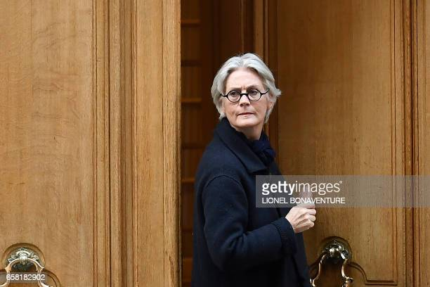 TOPSHOT Penelope Fillon the wife of French presidential election candidate for the rightwing Les Republicains party leaves her appartment building on...