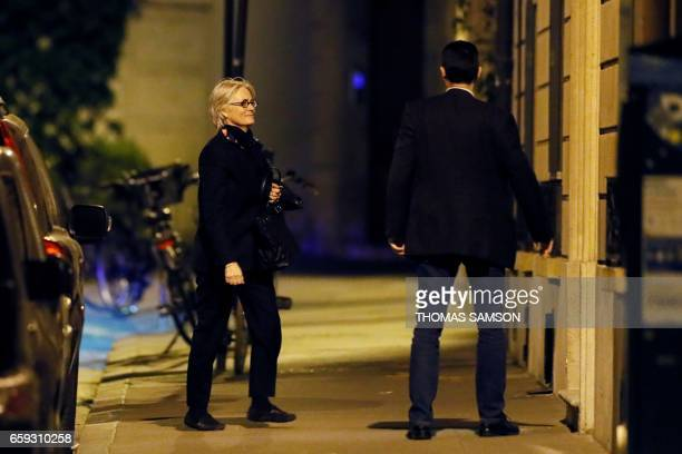 TOPSHOT Penelope Fillon the wife of French presidential election candidate for the rightwing Les Republicains party walks towards her appartment...
