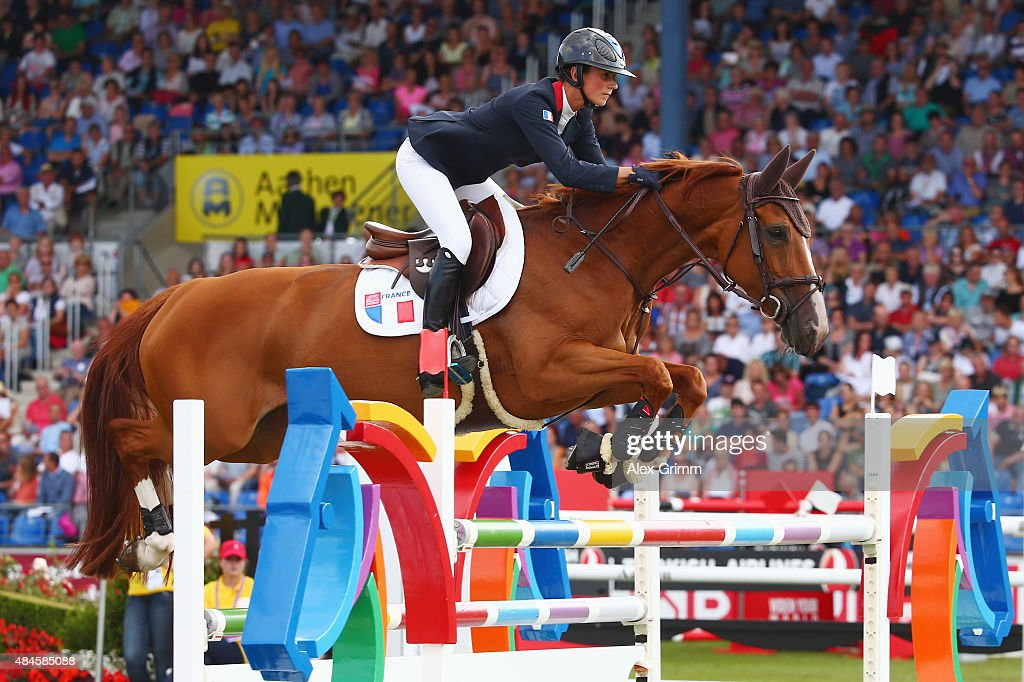 <a gi-track='captionPersonalityLinkClicked' href=/galleries/search?phrase=Penelope+Leprevost&family=editorial&specificpeople=5534219 ng-click='$event.stopPropagation()'>Penelope Leprevost</a> of France competes on her horse Flora de Mariposa during the Mercedes-Benz Prize Team Show Jumping competition on Day 9 of the FEI European Equestrian Championship 2015 on August 20, 2015 in Aachen, Germany.