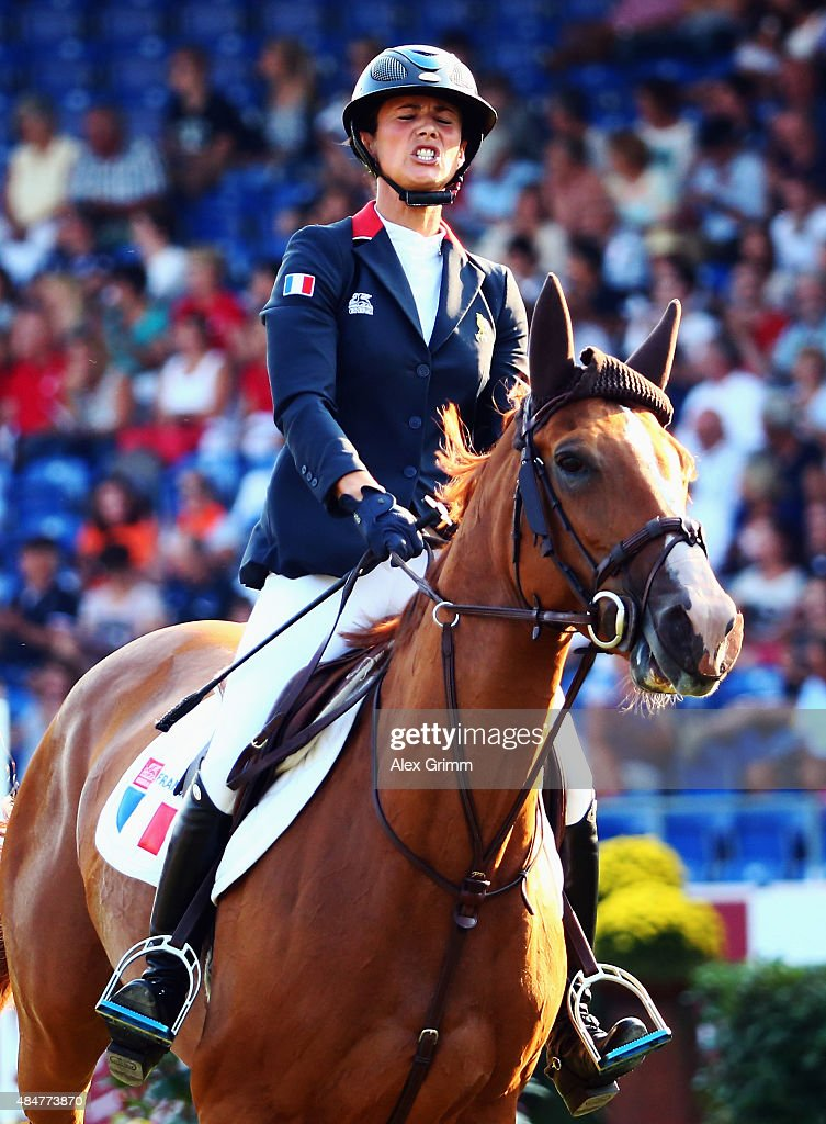 <a gi-track='captionPersonalityLinkClicked' href=/galleries/search?phrase=Penelope+Leprevost&family=editorial&specificpeople=5534219 ng-click='$event.stopPropagation()'>Penelope Leprevost</a> of France reacts on her horse Flora de Mariposa after competing in the second round of the Mercedes-Benz Prize Show Jumping team competition on Day 10 of the FEI European Equestrian Championship 2015 on August 21, 2015 in Aachen, Germany.